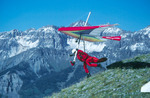 Hang-glider pilot launches from Gold Hill, Telluride Hang Gliding Festival, Colorado