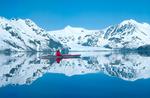 Bill Baker sea-kayaking in Aialik Bay, Kenai Fjords National Park, near Seward, Alaska