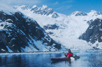 Bill Baker sea-kayaking past the Holgate Glacier, day 5, Kenai Fjords National Park, near Seward, Alaska