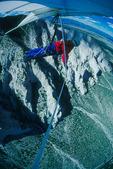 Chris Melle flying his hang-glider near Mt. Princeton, near Buena Vista, Colorado