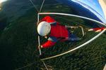 Chris Melle flying his hang-glider near Badger Mountain, South Park, near Fairplay, Colorado