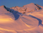 13,365-foot Gold Dust Peak & wind-sculpted snow at sunset, Holy Cross Wilderness, near Vail, Colorado