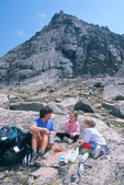 Cora, Emily and Audrey Randall picnicking beneath Spearhead, Rocky Mountain National Park, near Estes Park, Colorado