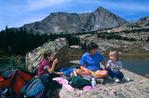 Emily, Cora and Audrey Randall picnicking at Lion Lake, Rocky Mountain National Park, near Estes Park, Colorado