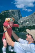 Cora Randall playing with her four-month-old daughter Emily at Dream Lake, Hallett Peak behind, Rocky Mountain National Park, near Estes Park, Colorado