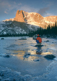 Glenn Randall looks at Notchtop at sunrise from Two Rivers Lake, Rocky Mountain National Park, near Estes Park, Colorado