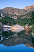 Cora Randall enjoys the sunrise at Little Rock Lake, Rocky Mountain National Park, near Estes Park, Colorado