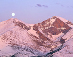 Full moon setting over Mt. Meeker and Longs Peak at sunrise, Rocky Mountain National Park, Colorado.
