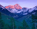Capitol Peak at sunset from the Ditch Trail, Maroon Bells-Snowmass Wilderness, Colorado.