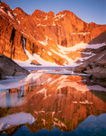 Longs Peak reflected in Chasm Lake at sunrise in July, Rocky Mountain National Park, Colorado