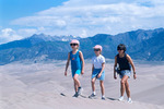 Mother and daughters hiking in Great Sand Dunes National Park, Colorado