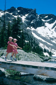 Girls playing on bridge, Rocky Mountain National Park, Colorado