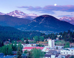 Full moon setting over Estes Park and Longs Peak, Colorado