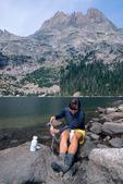 Cora Randall filtering water at Black Lake, Rocky Mountain National Park, Colorado