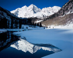 The Maroon Bells and Maroon Lake in winter, Maroon Bells-Snowmass Wilderness, White River National Forest, Colorado.