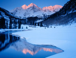 The Maroon Bells from Maroon Lake in winter at sunrise, Maroon Bells-Snowmass Wilderness, Colorado