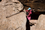 Emily Randall climbing a ladder on the hike to Druid Arch, Elephant Canyon, Needles District, Canyonlands National Park, Utah