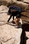 Cora Randall climbing a ladder on the hike to Druid Arch, Elephant Canyon, Needles District, Canyonlands National Park, Utah