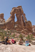 Cora, Emily, Audrey and Glenn Randall picnicking beneath Druid Arch, Needles District, Canyonlands National Park, Utah