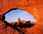 Turret Arch through North Window at sunrise, Windows area, Arches National Park, Utah