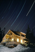 Star trails over the Polar Star Inn, Tenth Mountain Division hut system, Colorado