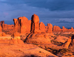 The Windows area at sunset on a stormy evening, Arches National Park, Utah