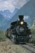 The Durango & Silverton Narrow-Gauge Railroad nearing Silverton, Colorado, with Pigeon and Turret peaks rising behind.