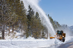 Rotary snowplow clearing the Bear Lake parking lot after a 44-inch snowfall on April 19, 2009, Rocky Mountain National Park, Colorado