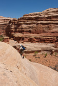 Glenn Randall scrambling up the trail from the Maze to Brimhall Point, Maze District, Canyonlands National Park, Utah
