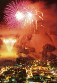 Fireworks over Aspen Mountain and the town of Aspen during Winterskol, Colorado