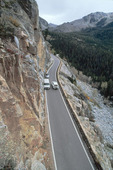 Two cars pass each other carefully on the narrowest part of the Independence Pass road east of Aspen, Colorado