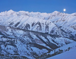 Full moon setting over Cathedral Peak, White River National Forest, near Aspen, Colorado