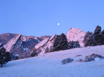 Full moon setting over the Flatirons, Boulder Mountain Parks, near Boulder, Colorado