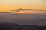 Pikes Peak rises above the fog blanketing South Park at sunrise as seen from the summit of 14,286-foot Mt. Lincoln, Mosquito Range, Colorado