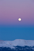 Full moon rising over the Mosquito Range, seen from the summit of 14,433-foot Mt. Elbert in January, San Isabel National Forest, Colorado