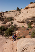 Audrey Randall climbing out of Range Canyon, Ernies Country, Maze District, Canyonlands National Park, Utah