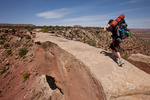 Audrey Randall crossing China Neck on the Golden Stairs trail, Maze District, Canyonlands National Park, Utah