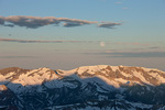 Moonset over Treasure and Treasury mountains from the summit of 14,014-foot North Maroon Peak, Maroon Bells-Snowmass Wilderness, Colorado