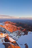 Looking north from the summit of 14,110-foot Pikes Peak at sunrise, near Colorado Springs, Colorado