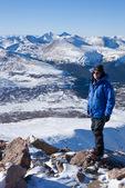 Glenn Randall on the summit of 14,060-foot Mt. Bierstadt, Grays and Torreys Peaks behind, Mount Evans Wilderness, Colorado