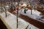 Holiday lights on the Pearl St. Mall after a December snowfall, Boulder, Colorado