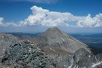 Cumulus cloud towers over Mt. Lindsey as seen from the summit of 14,042-foot Ellingwood Peak, Sangre de Cristo Wilderness, Colorado