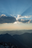 Crepuscular rays (god beams) from the summit of 14,267-foot Torreys Peak, near Georgetown, Colorado