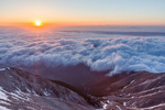 A sea of fog fills the valley of the Arkansas River as seen from the summit of Mt. Princeton at sunrise, San Isabel National Forest, Colorado