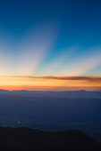 God beams (crepuscular rays) from the summit of Mt. Shavano at sunrise, San Isabel National Forest, Colorado