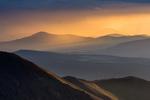 Crepuscular rays (god beams) at sunrise from the summit of San Luis Peak, La Garita Wilderness, Colorado