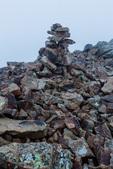 The summit cairn on Sunshine Peak immersed in fog, Redcloud Peak Wilderness Study Area, Colorado