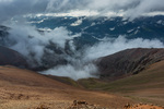 Mist fills the valley of the Lake Fork of the Gunnison River, Redcloud Peak Wilderness Study Area, Colorado