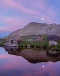Moonrise over Peak 13,300, reflected in a pond below Columbine Lake, San Juan National Forest, Colorado