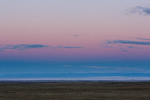 Twilight wedge over fog banks filling the San Luis Valley from Great Sand Dunes National Park, Colorado